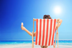 Woman holding an ice cream by the ocean Royalty Free Stock Image