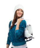 Woman holding ice skates for winter ice skating sport activity. Young woman holding ice skates for winter ice skating sport activity in white hat smiling stock images