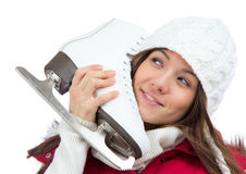 Woman holding ice skates for winter ice skating sport. Young woman holding ice skates for winter ice skating sport activity in white hat smiling isolated on a Stock Images