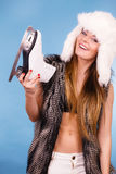 Woman holding ice skates, winter sport Royalty Free Stock Photography