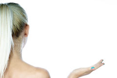 Woman holding an imaginary object Royalty Free Stock Image