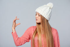 Woman holding imaginary product Royalty Free Stock Image
