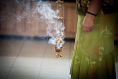 The woman holding the incense. In the Orthodox Christian Church Royalty Free Stock Image