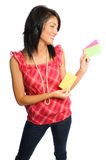 Woman holding index cards. Attractive hispanic woman on a white background holding school or office supplies Royalty Free Stock Images