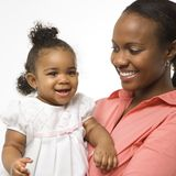 Woman holding infant girl. stock photos