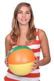 Woman holding an inflatable ballon. Royalty Free Stock Photos