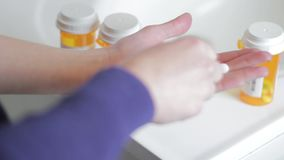 Woman holding and injesting an array of prescription pills. Shot it color and in 1080p stock video