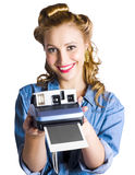 Woman holding instant camera Royalty Free Stock Photo