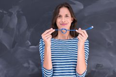 Woman holding a internet cable in front of chalk drawing board Royalty Free Stock Images