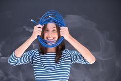 Woman holding a internet cable in front of chalk drawing board Royalty Free Stock Photos