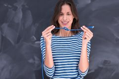 Woman holding a internet cable in front of chalk drawing board Stock Photos