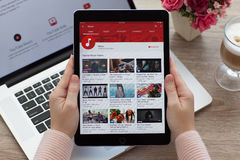 Woman holding iPad Pro Space Gray with website YouTube. Alushta, Russia - October 20, 2016: Woman holding a iPad Pro Space Gray with video sharing website Stock Photos