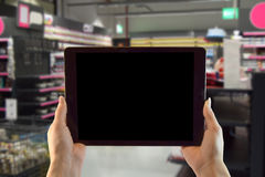 Woman Holding an Ipad in a Store or with transparent background Stock Photos