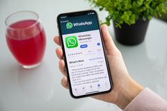 Woman holding iPhone X with social networking service WhatsApp. Alushta, Russia - September 24, 2018: Woman holding iPhone X with social networking service stock photo