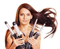 Woman holding iron curling hair. Young woman holding iron curling hair. Isolated Stock Images