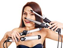 Woman holding iron curling hair. Stock Photo