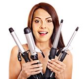 Woman holding iron curling hair. Stock Image