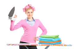 Woman holding an iron and ironing board Royalty Free Stock Image