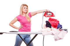 Woman holding iron about to do ironing Stock Photos