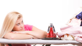 Woman holding iron about to do ironing Stock Images