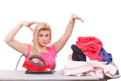 Woman holding iron about to do ironing Royalty Free Stock Images