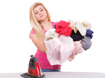 Woman holding iron about to do ironing Royalty Free Stock Photo