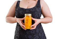Woman holding a jar of homemade peaches Royalty Free Stock Photography