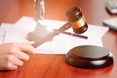 Woman holding judge gavel. Law Office Royalty Free Stock Photos