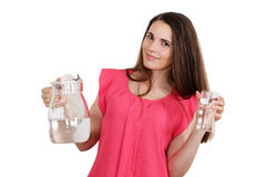Woman holding a jug of water and a glass Royalty Free Stock Photo
