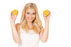 Woman holding juicy oranges Stock Images