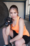 Woman holding a kettlebell - fitness Stock Images