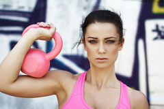 Woman holding kettlebell Royalty Free Stock Photography