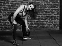 Woman holding the kettlebell royalty free stock image