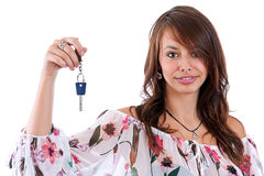 Woman holding a key Stock Photo