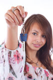 Woman holding a key Stock Images