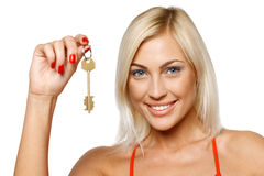 Woman holding a key Royalty Free Stock Photos