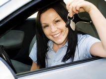Woman holding key in the car Royalty Free Stock Photos