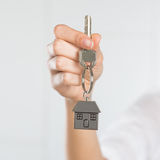 Woman holding key of her new house Royalty Free Stock Photo
