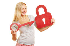 Woman holding key and lock Stock Images