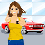 Woman holding the key and showing thumbs up Royalty Free Stock Image