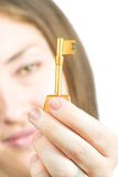 Woman holding a key of success in focs Royalty Free Stock Photos