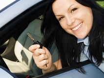 Woman holding key to the car Royalty Free Stock Photo