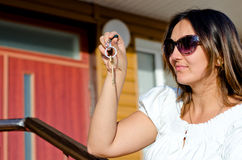 Woman holding the key to a property Stock Images