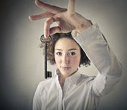 Woman holding a key. Young woman holding a vintage key Stock Photo