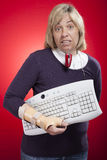 Woman holding a keyboard with carpal tunnel injury Royalty Free Stock Image