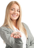 Woman holding keys. Portrait of young beautiful business woman holding keys, focus is on the keys Royalty Free Stock Images