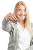 Woman holding keys. Portrait of young beautiful business woman holding keys, focus is on the keys Royalty Free Stock Photography