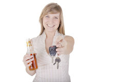 Woman holding keys Royalty Free Stock Photos
