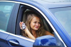 Woman holding keys from car Royalty Free Stock Photography