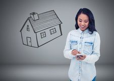 Woman Holding keys with house home drawing in front of vignette Stock Photos
